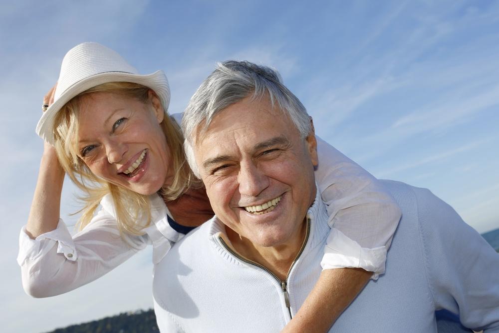 Portrait of cheerful senior couple having fun at the beach.jpeg