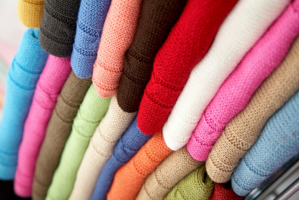 colourful clothes stacked in a retail store - woolen jumpers.jpeg